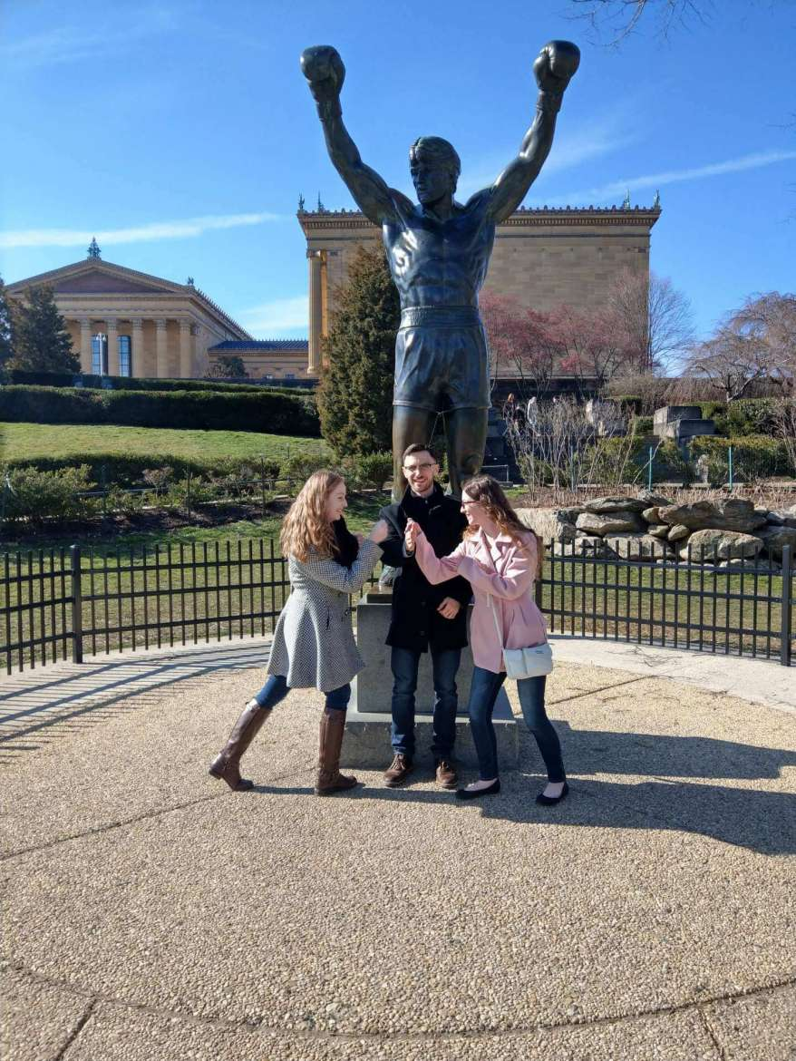 Dr. Matthew J. Kushin, associate professor of mass communications, and students Sarah Burke, Hedgesville, and Ellen Buchanan, Myersville, Maryland, took a few minutes to visit the Rocky statue in Philadelphia during a recent National Millennial Community spring break trip. Pictured (l. to r.) are Buchanan, Kushin, and Burke.
