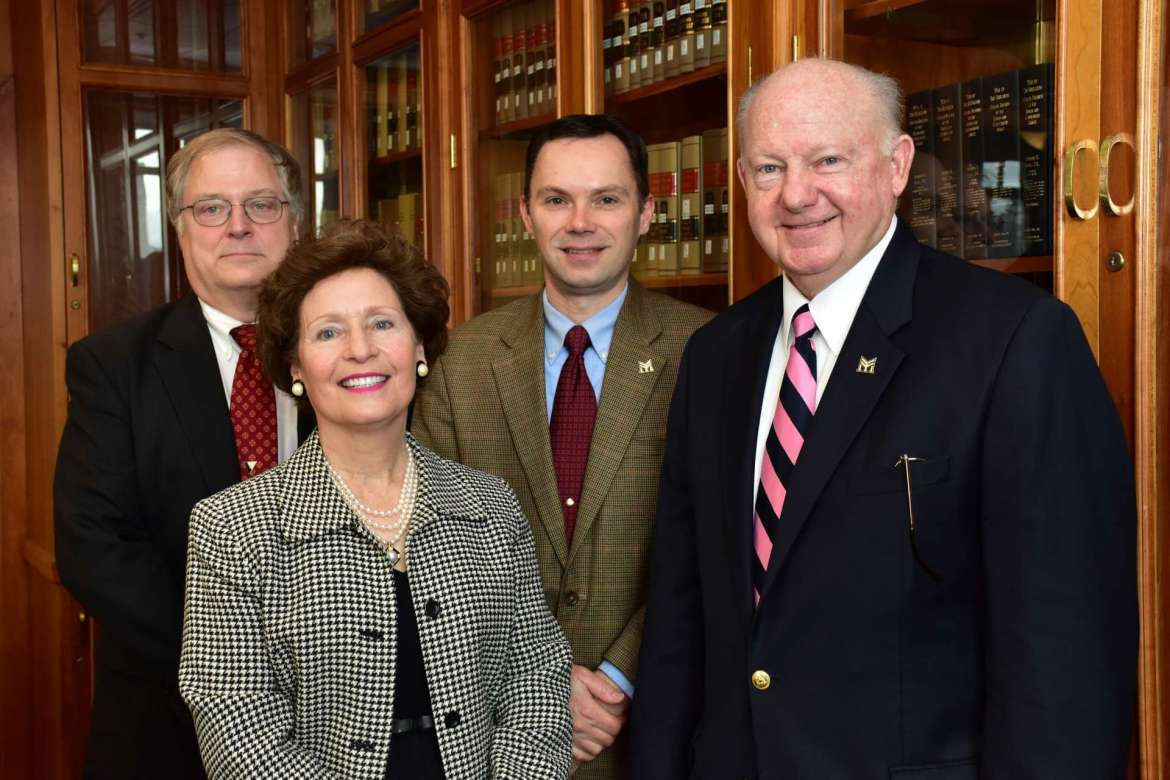 Farmers and Mechanics Mutual Insurance, which is headquartered in Martinsburg, requested that Shepherd University's College of Business develop a risk management and insurance program to help address the projected need for insurance professionals. Pictured (l. to r.) are Dr. Ben Martz, dean of the College of Business; Dr. Mary J.C. Hendrix, Shepherd president; Dan Otto, senior vice president and chief financial officer, Farmers and Mechanics Mutual Insurance; and Jim Dailey, board of directors chair, Farmers and Mechanics Mutual Insurance.