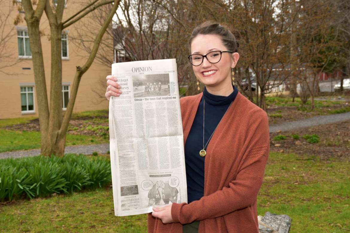 """Emily Keefer, an English Education major from Martinsburg, holds a copy of the Odessa American newspaper with an opinion piece she wrote after visiting the city to learn what inspired the book, movie, and TV show """"Friday Night Lights."""""""