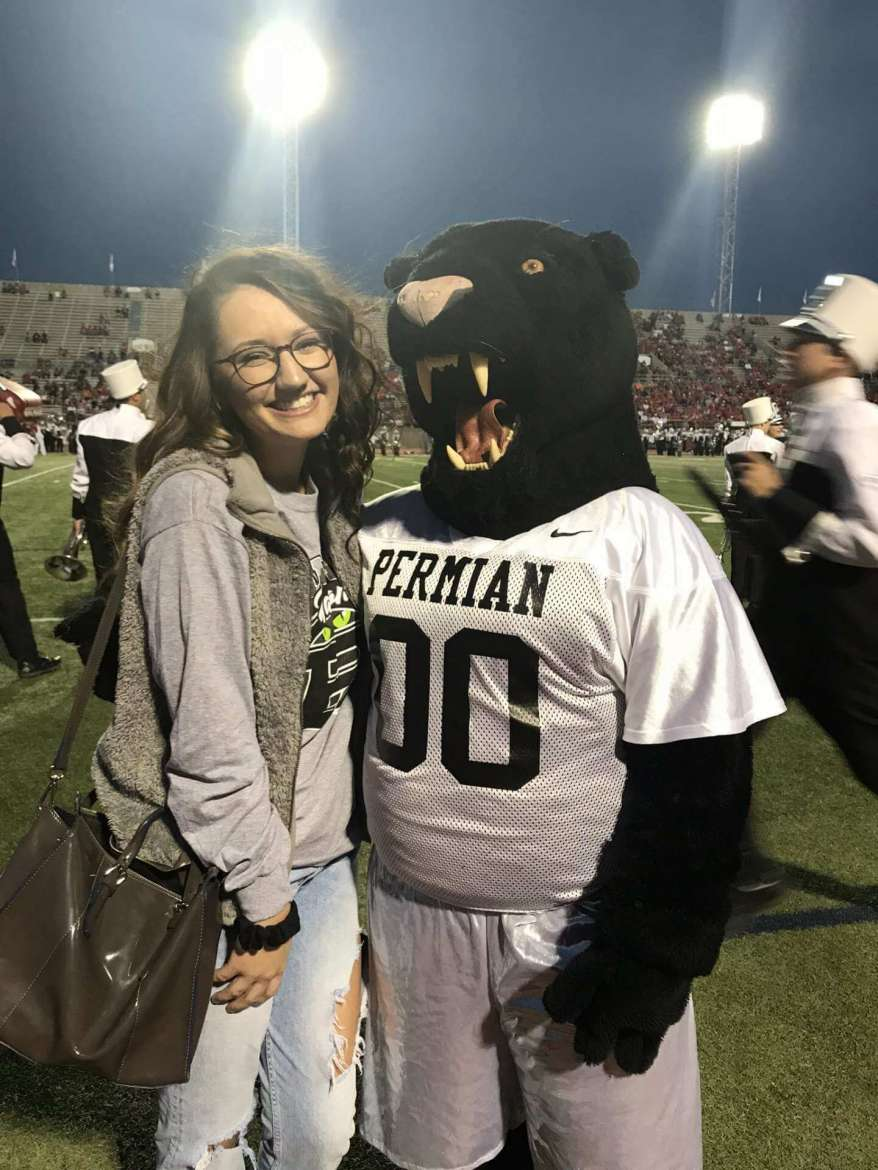 Emily Keefer met the mascot for the Permian Panthers during a football game she attended in Odessa, Texas.