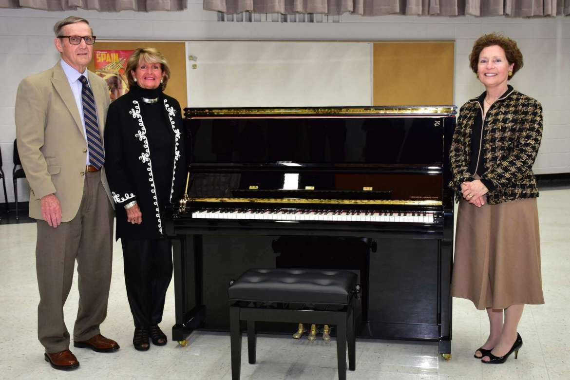 Shepherd alumni Al and Sara Lueck donated a Boston UP-126 Performance Edition upright piano designed by Steinway & Sons to Shepherd University's All-Steinway Campaign. Pictured with the piano are (l. to r.) Allen and Sara Lueck and Shepherd President Mary J.C. Hendrix.