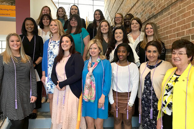 Shepherd's Nursing Honor Society inducted 25 members on April 15. They are, front row (l. to r.), Olivia Carlisle, Martinsburg; Kendra Wenner, Harpers Ferry; Dr. Angela Fetty, assistant professor of nursing; Andrea Barnett, Hagerstown, Maryland; Muna Bahsali, adjunct professor; and Mary Beachley, adjunct professor and keynote speaker. Second row, Aniya Saunders-Moseley, Kearneyville; Ghadeer Ibrahim, Hagerstown, Maryland; Kathrine Neff, New Windsor, Maryland; Heather Pleasants, Hedgesville; Amber Lee, Falling Waters; Ellen Joliet, Hagerstown, Maryland; Justina Workman, adjunct professor; and Kayla Corbin, Romney. Third row, Madelyn Trucks, Inwood; Alesha Unger, Bunker Hill; Allyson Leonard, Martsinburg; Stephanie Lopez, Martinsburg; Skyler Casto, Sharpsburg, Maryland; and Catherine Makanjuola, adjunct professor.