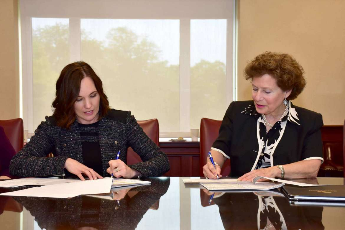 Dr. Carol Rothstein (left), Hagerstown Community College acting chief academic officer, and Dr. Mary J.C. Hendrix, Shepherd president, sign eight 2+2 agreements that will allow students who earn certain two-year degrees at HCC to seamlessly transfer to Shepherd.