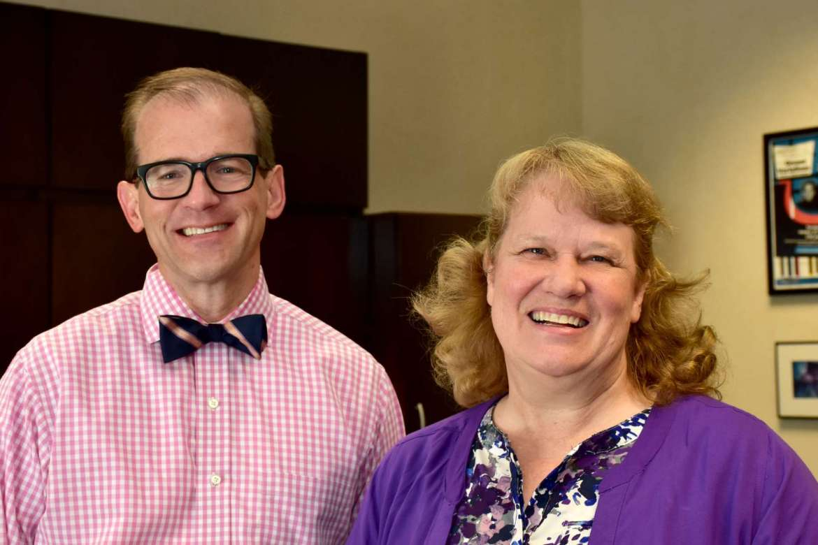Dr. Scott Beard (left), acting provost, and Dr. LeAnn Johnson, assistant professor of education.