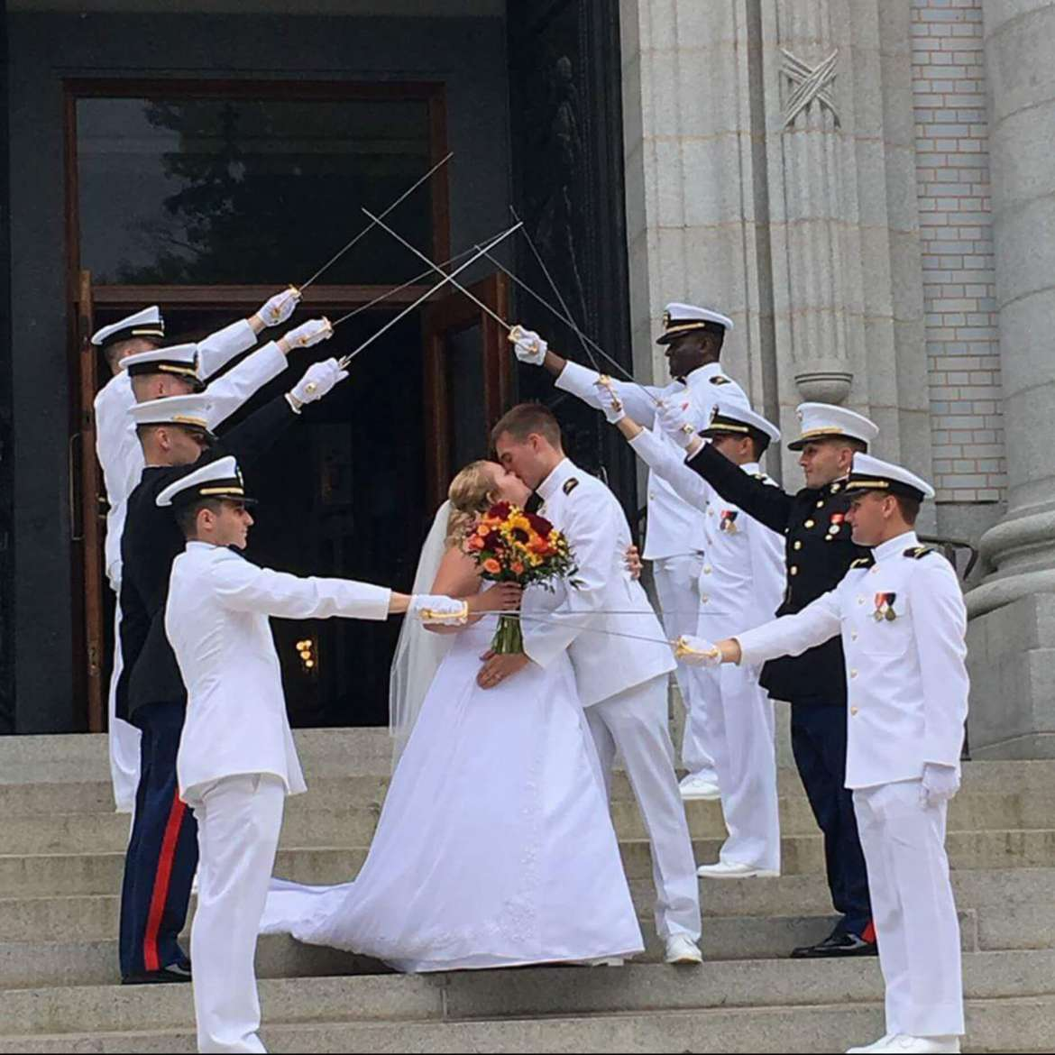 Casey and Hannah Densmore's wedding took place at the U.S. Naval Academy Chapel on May 27. Photo by Andrea Cooper.