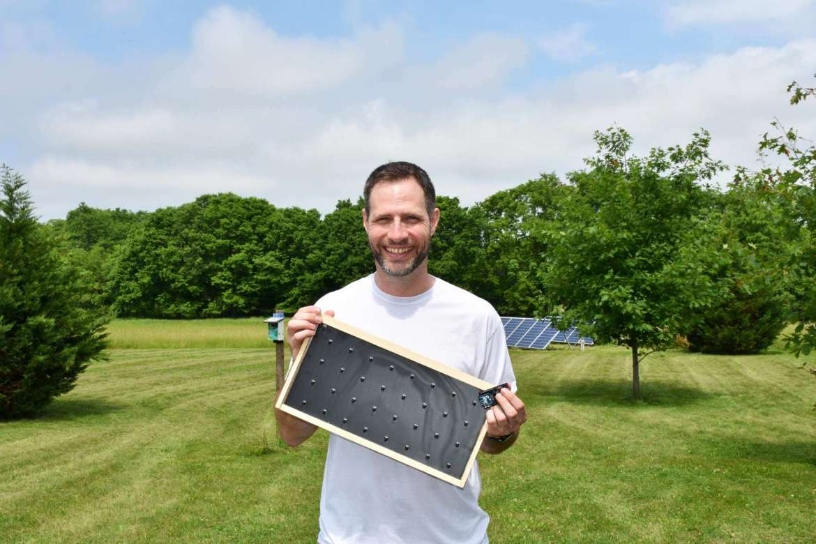 Dr. Jeff Groff, chair of the Institute of Environmental and Physical Sciences, is designing prototype beehive frames embedded with temperature sensors to monitor his hives.
