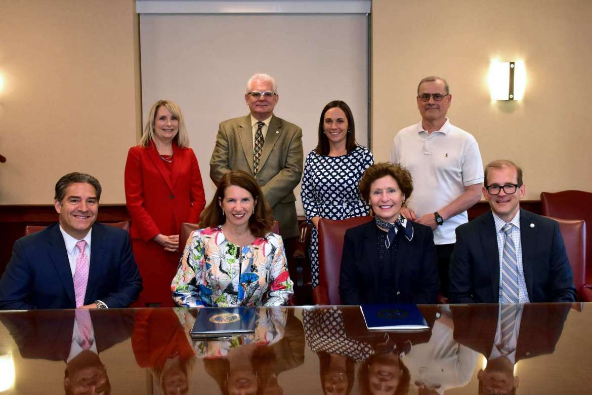 Shepherd University and Shenandoah University recently signed an articulation agreement that will make it possible for students to attend Shepherd for three years and spend their fourth year at Shenandoah's Bernard J. Dunn School of Pharmacy finishing their bachelor's degree while simultaneously earning their Pharm.D. Pictured (front row, l. to r.) are Dr. Robert DiCenzo, dean, Bernard J. Dunn School of Pharmacy; Dr. Tracy Fitzsimmons, president, Shenandoah University; Dr. Mary J.C. Hendrix, president, Shepherd University; and Dr. Scott Beard, acting provost, Shepherd University. Back row, Dr. Gina Peacock, assistant dean, Bernard J. Dunn School of Pharmacy; Dr. Robert Warburton, acting dean, Shepherd's College of Natural Sciences and Mathematics; Dr. Katie Sanders, director of admissions, Bernard J. Dunn School of Pharmacy; and Dr. Dan DiLella, chair, Shepherd's Department of Chemistry.