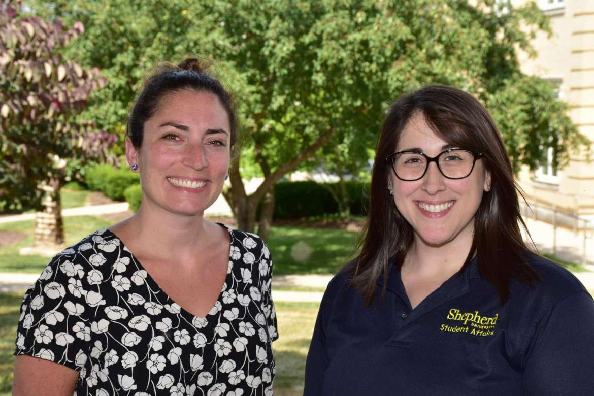 Julia Keough (left), success coach, and Julia Franks, director of student success and orientation programming, work with students in the Shepherd Success Academy to help them successfully transition from high school to college.