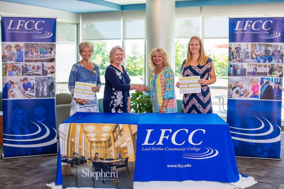 Pictured (l. to r.) are Dr. Stacey Kendig, chair of Shepherd's Department of Health, Physical Education, Recreation, and Sport; Dr. Virginia Hicks, Shepherd assistant provost of Academic and Community Outreach; Dr. Kim Blosser, LFCC president; and Stacey Ellis, program lead of LFCC's Health, Physical Education, and Recreation.