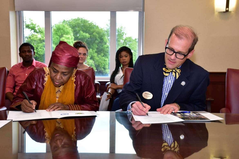 H.E. Prof. Hassana Alidou, Niger's ambassador to the U.S. (l.) and Dr. Dr. Scott Beard, Shepherd's provost sign an international enrollment partnership between Shepherd and the République du Niger.