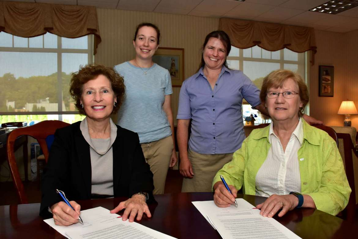 Shepherd and the Potomac Valley Audubon Society (PVAS) have signed an agreement to allow PVAS to build a new structure for chimney swifts on West Campus near Dunlop Hall. Pictured (seated, l. to r.) are Dr. Mary J.C. Hendrix, Shepherd president, and Suzanne Offutt, PVAS board president. Standing, (l. to r.) are Katelyn Walters, PVAS conservation and land manager, and Kristin Alexander, PVAS executive director.