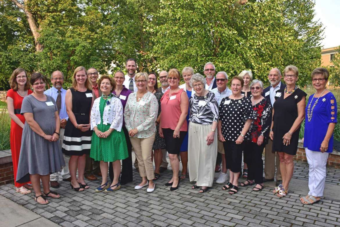 """The 2018 WISH grant recipients gather after the award program with members of the WISH advisory committee, Shepherd University President Mary J.C. Hendrix, and sponsor John Wolff. Pictured (front row, l. to r.) are Mary Runkles, Good Samaritan Free Clinic; Dana Rodriquez, Good Samaritan Free Clinic; Dr. Mary J. C. Hendrix, Shepherd president; Cosby Potter-Davis Good Samaritan Free Clinic; Vicki Barnard, CASA of the Eastern Panhandle; Bonnie Brannon, WISH grant committee chair; Pam Curtis, CASA of the Eastern Panhandle; Marilyn Schoon, CASA of the Eastern Panhandle; Bev Hughes, WISH Advisory Committee; and Mary """"Peachy"""" Staley, WISH Advisory Committee. Back row, Kara Renner, Good Samaritan Free Clinic; Randy Rodriquez, Good Samaritan Free Clinic; Dr. Peter Vila, associate professor of environmental and physical sciences, Tabler Farm; Dr. Sytil Murphy, associate professor of physics, Tabler Farm; Dr. Jeffrey Groff, chair, Institute of Environmental and Physical Sciences, Tabler Farm; Dr. Julia Sandy, associate professor of history, Catherine Weltzheimer House; Dr. Keith Alexander, associate professor of history, Catherine Weltzheimer House; Carolyn Fleenor, WISH advisory committee; John Wolff, sponsor, Bronfman Rothschild Wealth Advisors; Steve Shaffer, adjunct faculty, Tabler Farm; Liz Oates, WISH Advisory Committee; and Ross Curtis, CASA of the Eastern Panhandle."""