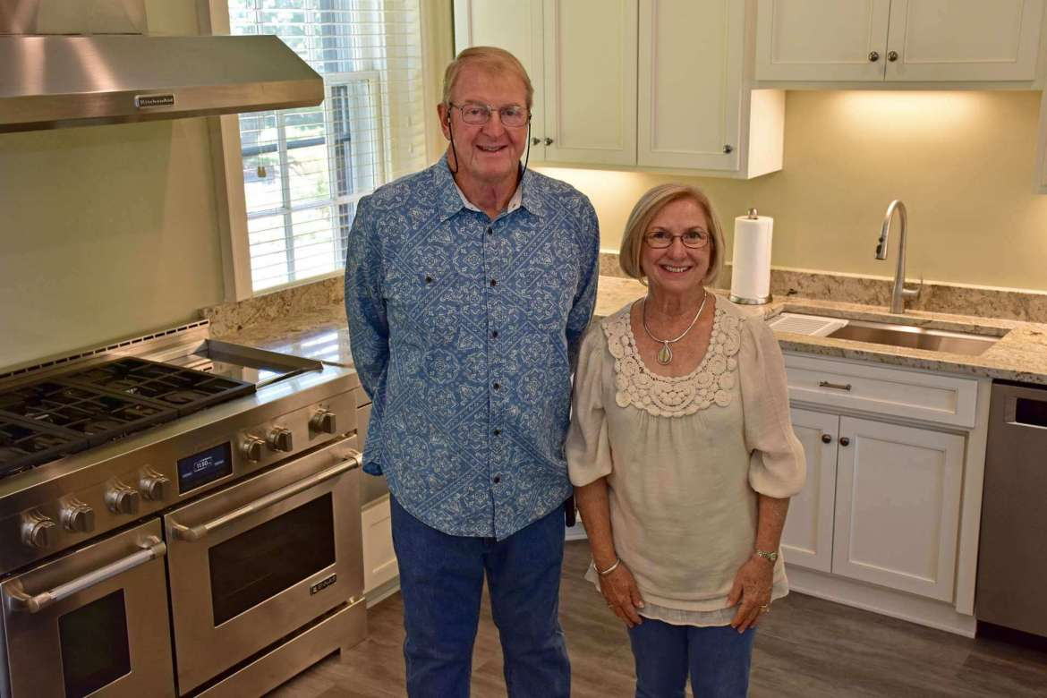Friends of Popodicon members and Shepherd alumni Pattie and Paul Wilmoth stand in the recently renovated kitchen that they helped design.