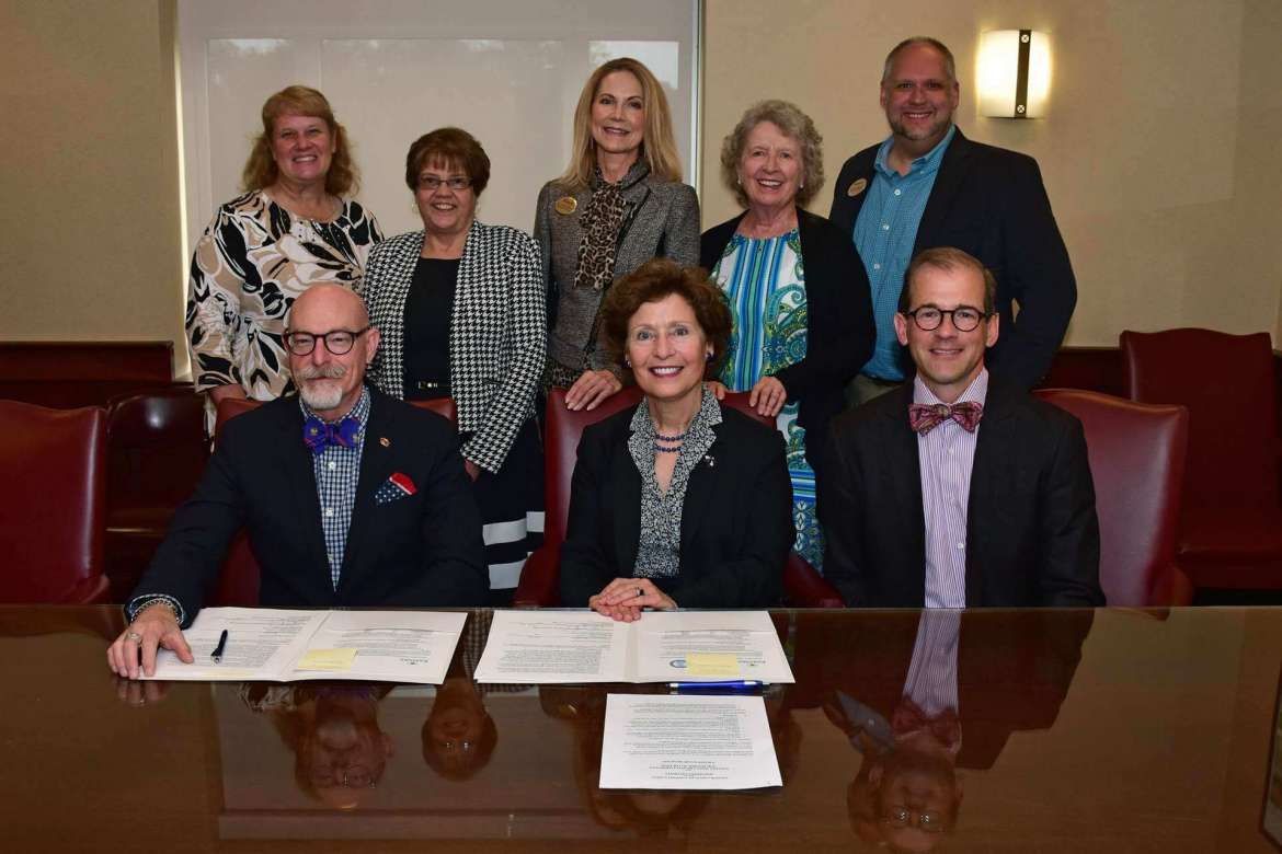 """Pictured (seated, l. to r.) are Dr. Charles """"Chuck"""" Terrell, Eastern president; Dr. Mary J.C. Hendrix, Shepherd president; and Dr. Scott Beard, Shepherd provost; back row, Dr. LeAnn Johnson, Shepherd assistant professor of education; Dr. Dori Hargrove, Shepherd assistant professor of education; Dr. Jennifer Penland, chair, Shepherd Department of Education; Dr. Virginia Hicks, Shepherd assistant provost for Academic Community Outreach; and Stephen McPherson, Shepherd coordinator of education preparation."""