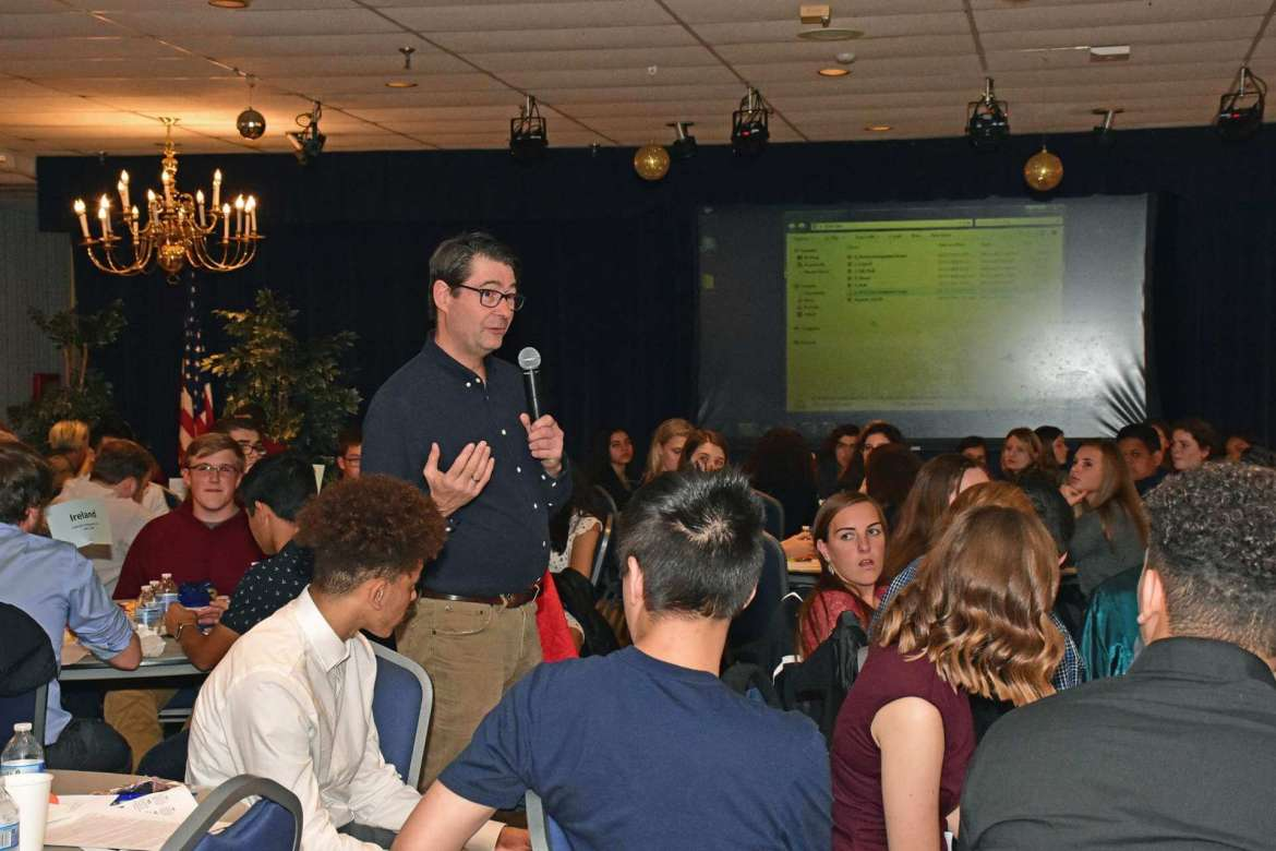 Dr. Aart Holtslag, co-chair, Department of Political Science and Global Studies, addresses high school students attending the annual World Affairs Seminar during the Model U.N. simulation.