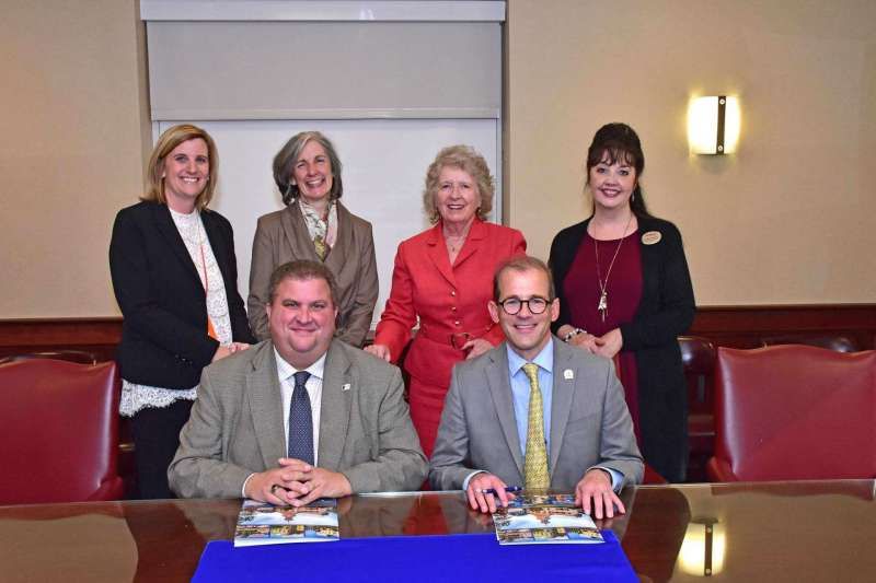 Pictured (seated, l. to r.) are Chris Cosentino, SMGHS president; and Dr. Scott Beard, Shepherd provost. Standing, Jennifer Carbaugh, SMGHS director of institutional advancement; Bridget Bartholomew, SMGHS principal; Dr. Virginia Hicks, Shepherd assistant provost, Community Outreach; and Barbara Kandalis, Shepherd program assistant, Community Outreach.