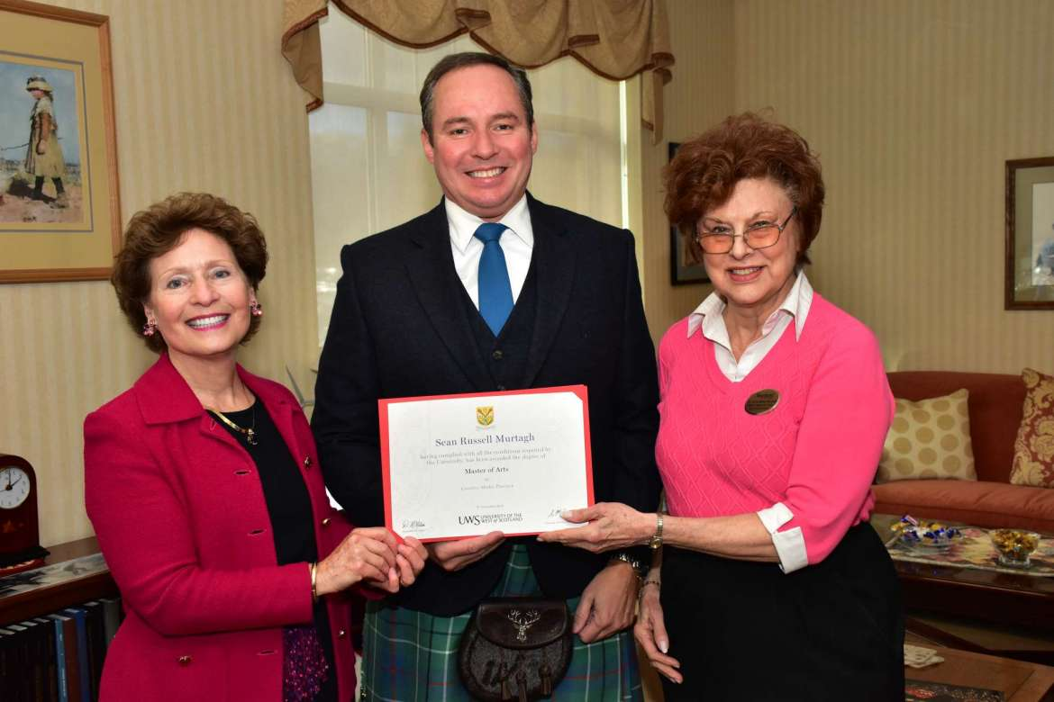 Sean Murtagh (c.) displays his degree from the University of the West of Scotland while wearing a kilt made of his family's plaid. Pictured with Murtagh are Shepherd President Mary J.C. Hendrix (l.) and Dr. Sylvia Bailey Shurbutt, coordinator, Appalachian Studies Program.