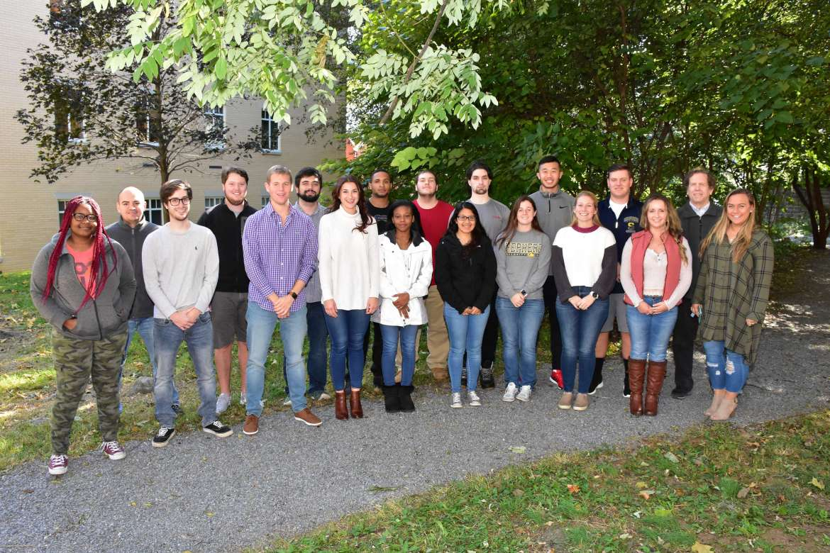 Shepherd's Business Strategy and Policy class is working with the Harpers Ferry Bolivar Merchants Association. Pictured (front row, l. to r.) are Daijah Thompson, Ranson; Jeremy Eckert, Williamsport, Maryland; Dustyn Icard, Thurmont, Maryland; Kierston Dudley, Hagerstown, Maryland; Markia Daniels, Warrenton, Virginia; Emily Hernandez, Alexandria, Virginia; Madison Bryant, Thurmont, Maryland; Victoria Manuel, Charles Town; Brooke Russell, Winchester, Virginia; and Greysen Lingg, Frederick, Maryland; back row, Julian Cespedes, Martinsburg; Erik Sween, Fairfax, Virginia; Hunter O'Neal, Martinsburg; Anthony Herbert III, Charles Town; Devan Greathouse, Martinsburg; Tyler Piccolo, Sound Beach, New York; Brandon Dang, Berryville, Virginia; Patrick Quigley, Harrisburg, Pennsylvania; and Dr. Michael Lynch, assistant professor of business administration.