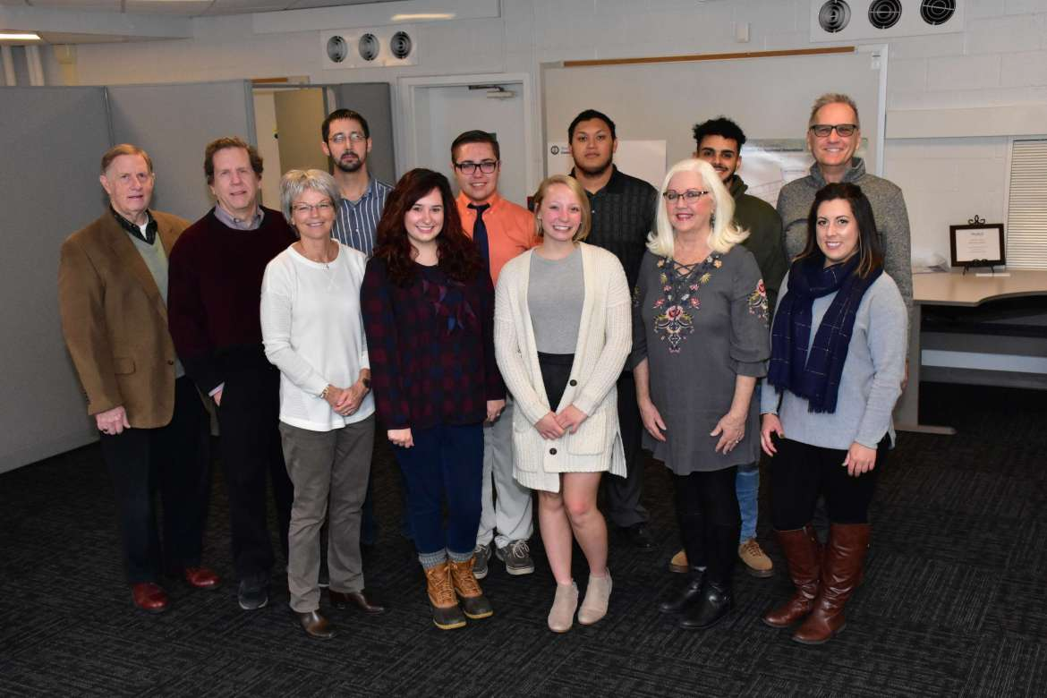Students in Shepherd's Introduction to Tourism class participated in a pilot project that matched students with individual Harpers Ferry merchants to help plan and promote specific events. Pictured (front row, l. to r.) are Dr. Stacey Kendig, chair, Department of Health, Physical Education, Recreation, and Sport; Anne Strotz, event and marketing manager, Harpers Ferry Event Barn; Emmy Strauss, health, physical education, recreation, and sport major, Williamstown; Cindi Dunn, owner, The Vintage Lady; and Spencer VanHoose, political science major, Martinsburg; back row, Curt McGee, vice president, Harpers Ferry Bolivar Merchants Association; Dr. Michael Lynch, assistant professor of business administration; Cory Reese, Regents Bachelor of Arts student, Martinsburg; Jim Ramey, health, physical education, recreation, and sport major, Winchester, Virginia; Michael Himes, health, physical education, recreation, and sport major, Harpers Ferry; Josh Snow, health, physical education, recreation, and sport major, Hagerstown, Maryland; and Dr. Greg Finch, adjunct professor and Harpers Ferry Bolivar Merchants Association president.