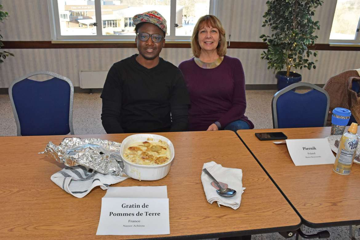 Nasser Achirou, a business administration major from Niger who won third place and a $15 prize, is pictured with his host mother Jean Anne Pugh, Shepherdstown.