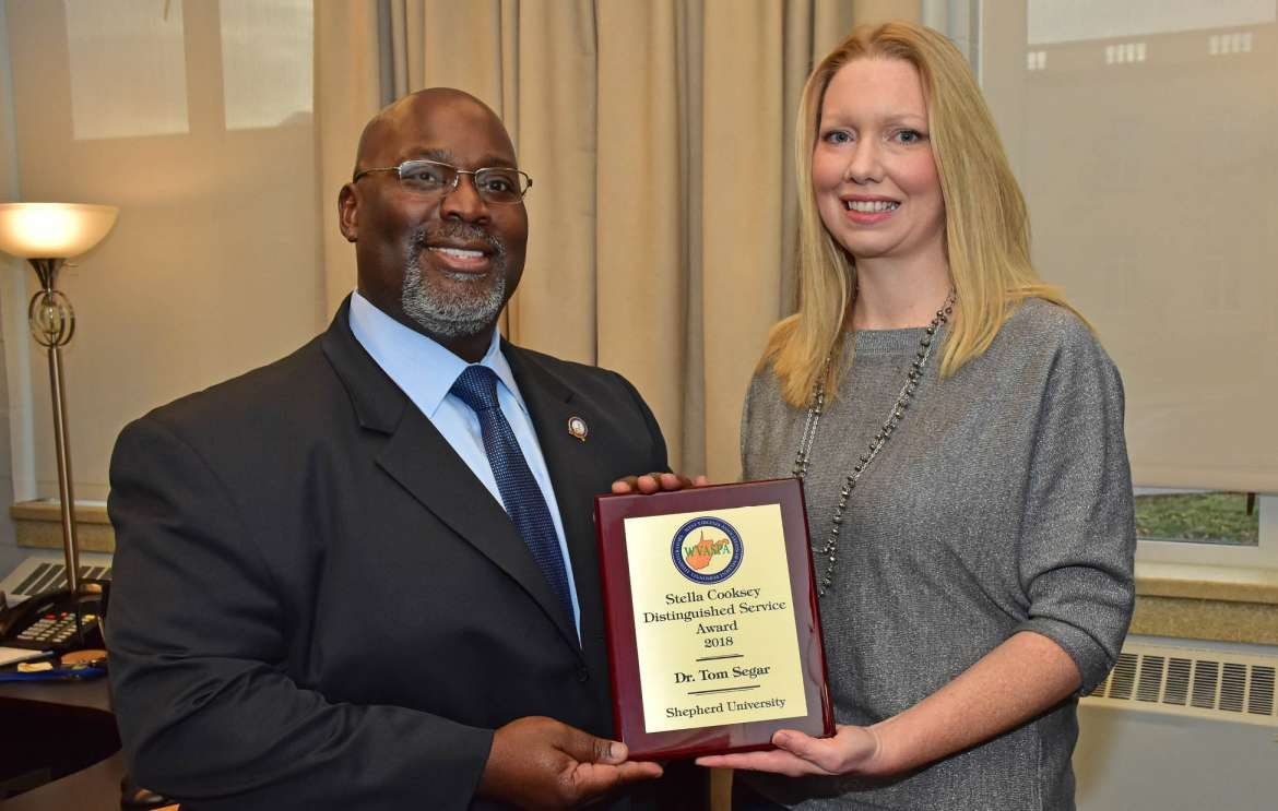Dr. Tom Segar, Shepherd's vice president for student affairs, was presented the 2018 Stella Cooksey Distinguished Service Award by Autumn Perry, immediate past president, West Virginia Association of Student Personnel Administrators.