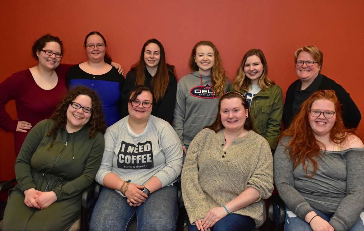 Pictured seated (l. to r.) are English majors Claudia McCarron, Charles Town; Gabrielle Hersey, Romney; Caitlyn Sheets, Hedgesville; and Alex Hippensteel, Shepherdstown; standing, Alex McCarron, Charles Town; Jessica Perez, Libertytown, Maryland; Lilli Sutton, Boonsboro, Maryland; Katharine Hardy, Shepherdstown; Paige Conrad, Shepherdstown; and Dr. Heidi Hanrahan, professor of English and Sigma Tau Delta chapter advisor.