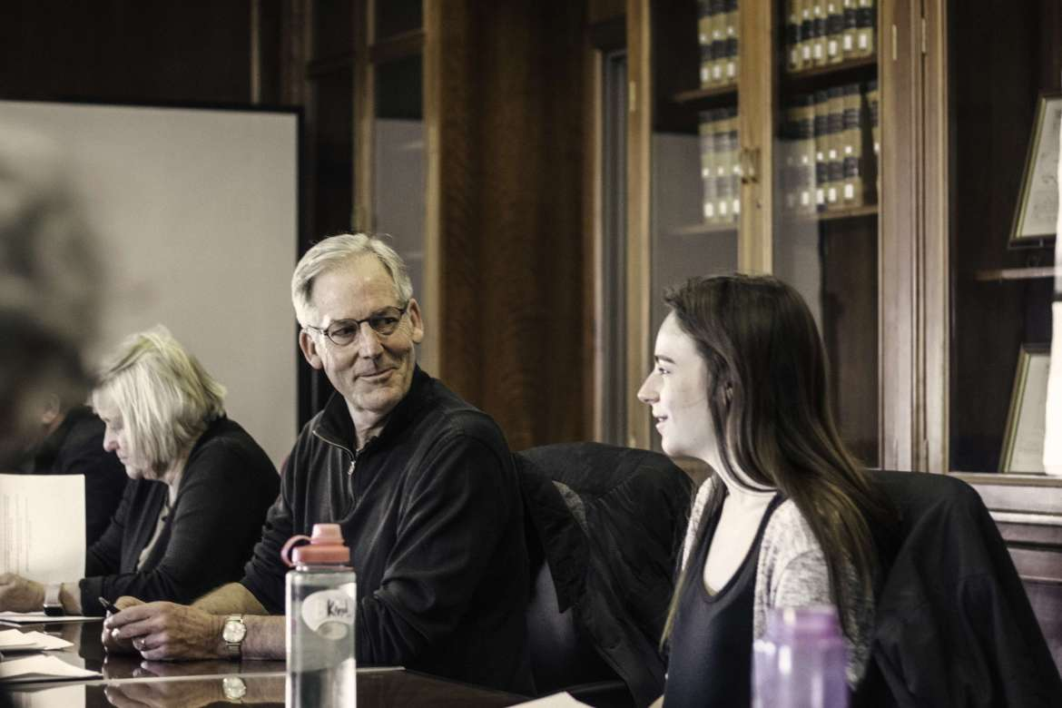 Maryland poet laureate Michael Collier speaks with Lilli Sutton (r.), an English major from Boonsboro, Maryland, who earned a scholarship to Collier's workshop.