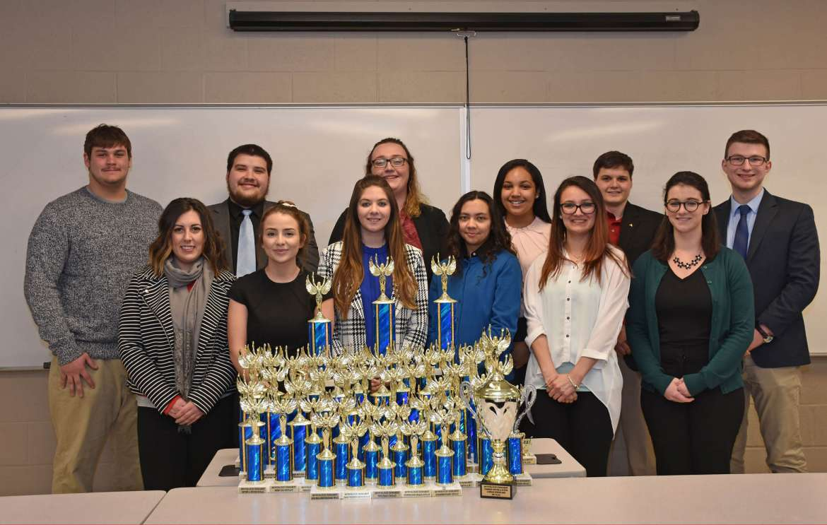 Pictured (front row, l. to r.) are Spencer VanHoose, Martinsburg; Madison Ronevich, Inwood; Miranda Jones, Huntingtown, Maryland; Jordan Jalil, Charles Town; Kristiana Carnivale, Inwood; and Ilynn Brennan, Fairmont. Back row, Eric Ostrow, Reisterstown, Maryland; Ryan Dudrow, Hedgesville; Aubrey Duckworth, Kingwood; Kyleigh Wallace, Shepherdstown; Jake Klepp-Egge, Westminster, Maryland; and Sam Brown, director, Debate and Forensics Team