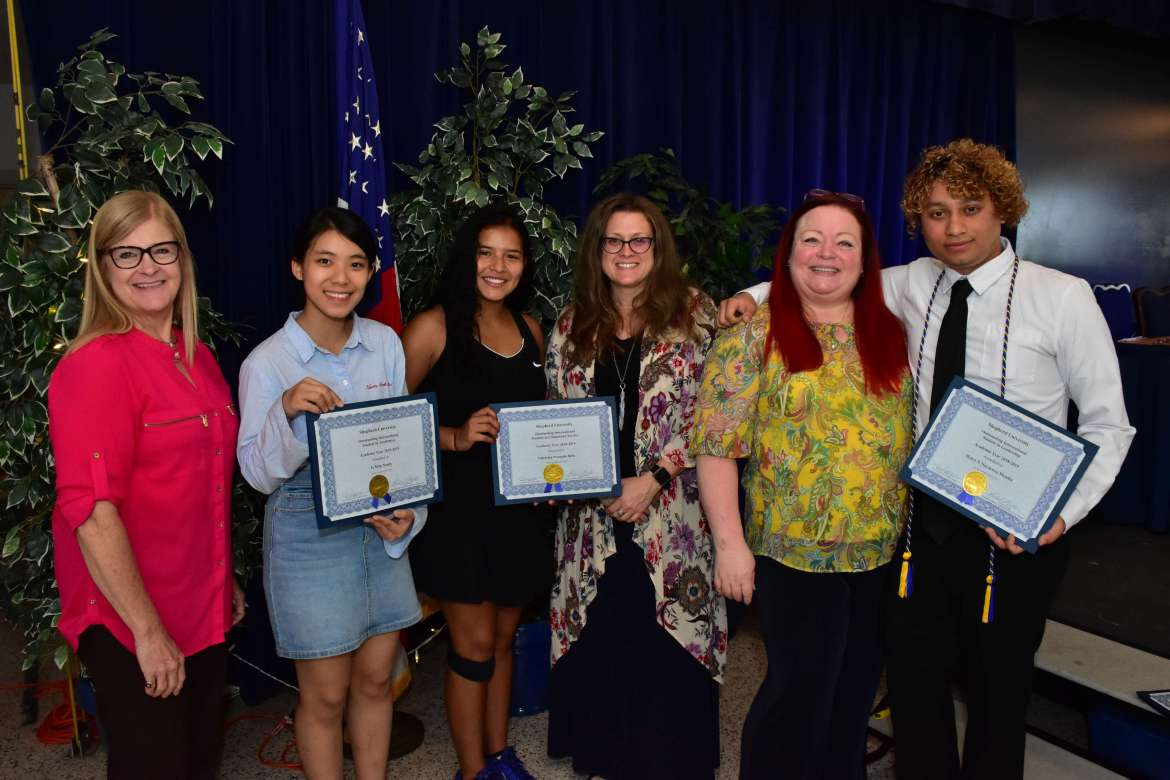 Pictured (l. to r.) are Dr. Lois Jarman, Smoketown Rotary member and Shepherd director of international affairs; Ja Seng Nsang, a business administration major from Myanmar, who was awarded the Outstanding International Student in Academics; Valentina Preciado-Bello, a business major from Columbia, who received the Outstanding International Student in Community Service award; Kim Foore, Martinsburg Sunrise Rotary Club; Pam Neely, Martinsburg Sunrise Rotary Club; and Henry Navarrete Mendez, a computer information sciences student from Chantilly, Virginia, who was given the Outstanding International Student in Leadership award.