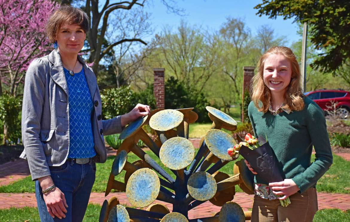 Pictured (l. to r.) are Kay Dartt, clinical faculty and manager of FASTEnER Lab, and Nevada Tribble, a Bachelor of Fine Arts student from Elkins and creator of the new sculpture on display in Popodicon's formal garden.