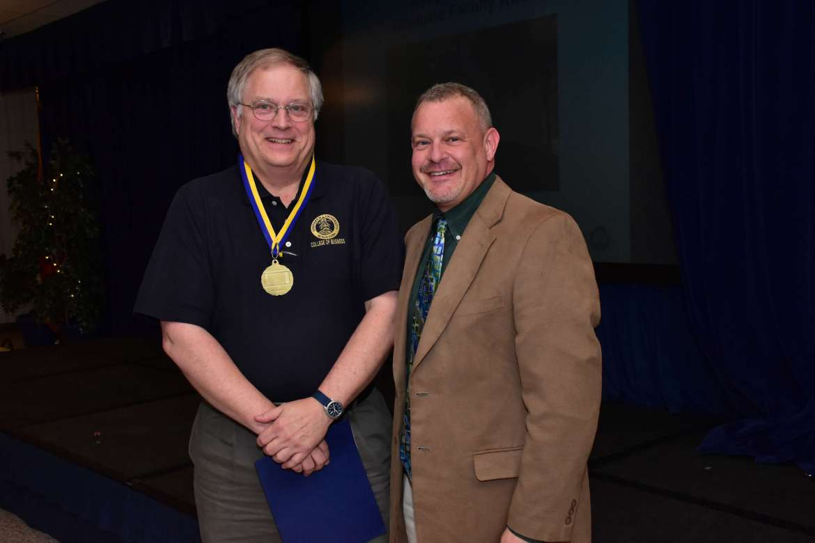 Dr. Ben Martz (l.), dean of the College of Business, Douglas C. Smith Graduate Faculty Award recipient, is shown with Dr. Richard Stevens, dean of graduate studies and faculty affairs.