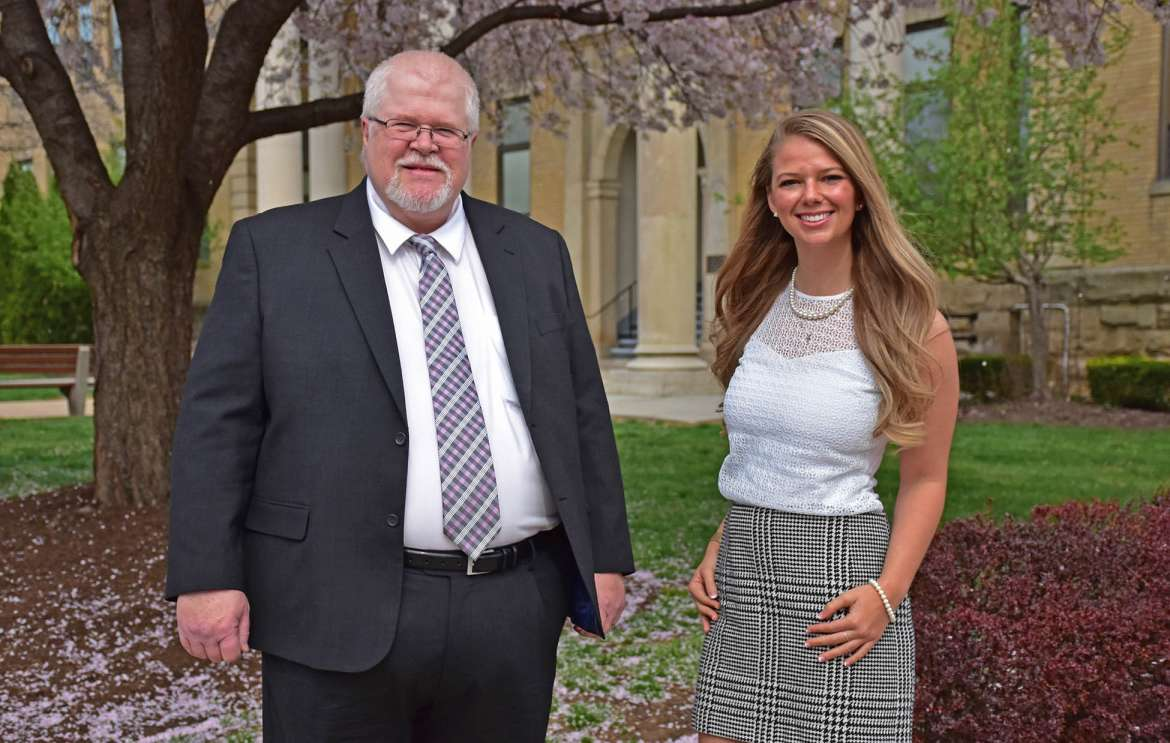 Pictured are Dr. Don Hillman (l.), adjunct business faculty, and Courtney Knill, business administration major, Charles Town.