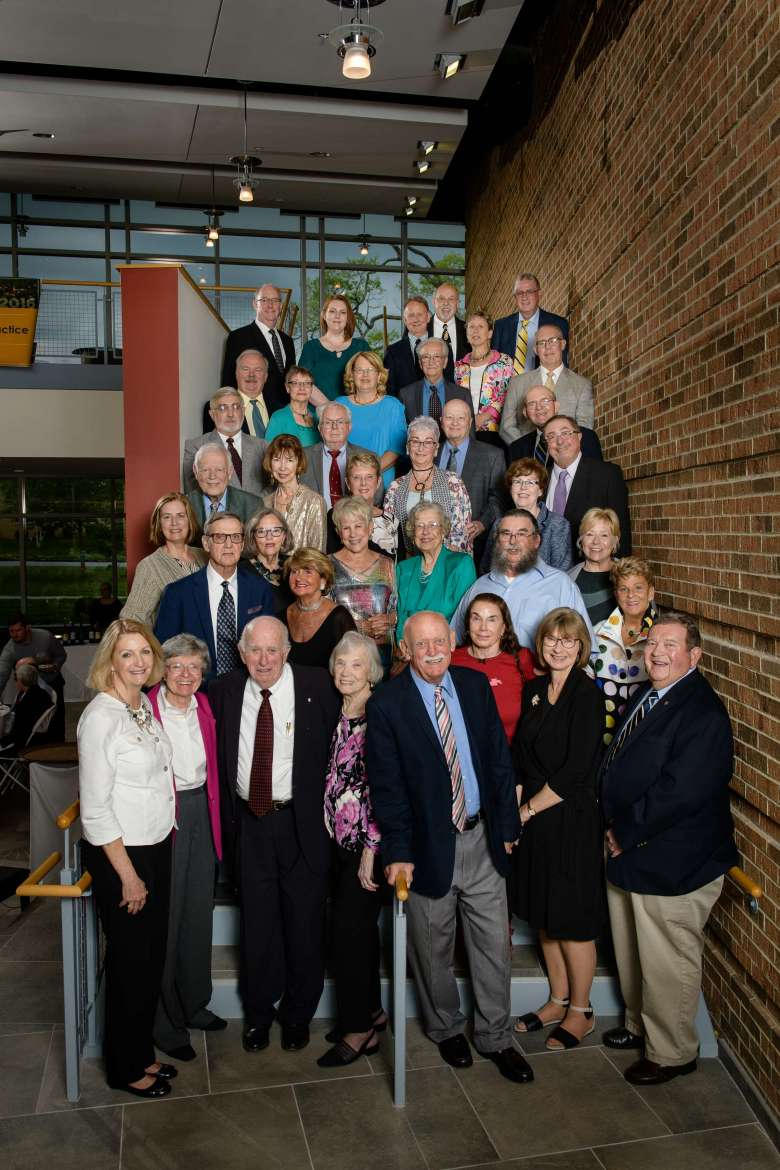 Members of the Joseph P. McMurran Society gathered in the atrium of Erma Ora Byrd Hall for the organization's annual dinner reception. Pictured (front row, l. to r.) are Monica Lingenfelter, Karen Cunningham, Richard Nickell, Barbara Nickell, Bill Blair, Sue Mentzer-Blair, and Karl Wolf. Second row, Al Lueck, Sara Lueck, Lynne Cosner, and Mary Jo Brown. Third row, Barbara Hume, Paula Mayes Coupe, Anne Small, Betty Lowe, Donald Cosner, and Susan Mills. Fourth row, Jack Egle, Pat Egle, Ann Hummer, Robin Renn, Phyllis Smock, and Ray Smock. Fifth row, Jim Watson, Mike Athey, Joseph Renn, III, and Gerald Dodson. Sixth row, Anders Henriksson, Ann Henriksson, Cynthia Smailes-Rybak, Erdem Ergin, and Walter Brown. Seventh row, Lynn Leatherman, Lyndsey Mastchat, Dan Starliper, Bill Lingenfelter, Joan Starliper, and Denny Barron.