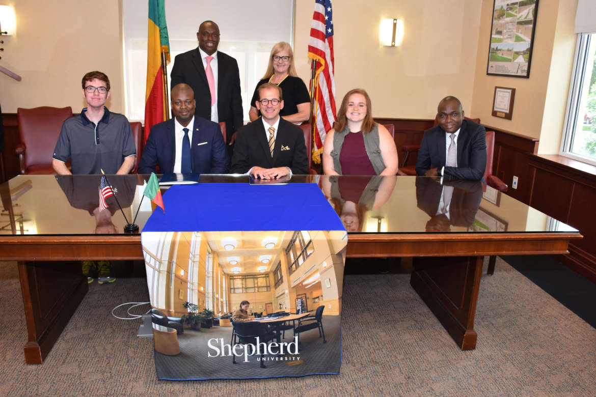 Pictured, seated (l. to r.) are Zach Runion, political science major, Charles Town; Gafari N. Dango, chargé d'affaires of the Embassy of Benin; Dr. Scott Beard, Shepherd provost; Caley Stefanizzi, global studies major, Boonsboro, Maryland; and Benjamin Agon, cultural attaché, Embassy of Benin. Standing, Siriki Diabate, Shepherd international recruiter and admissions officer, and Dr. Lois Jarman, Shepherd director of international affairs.