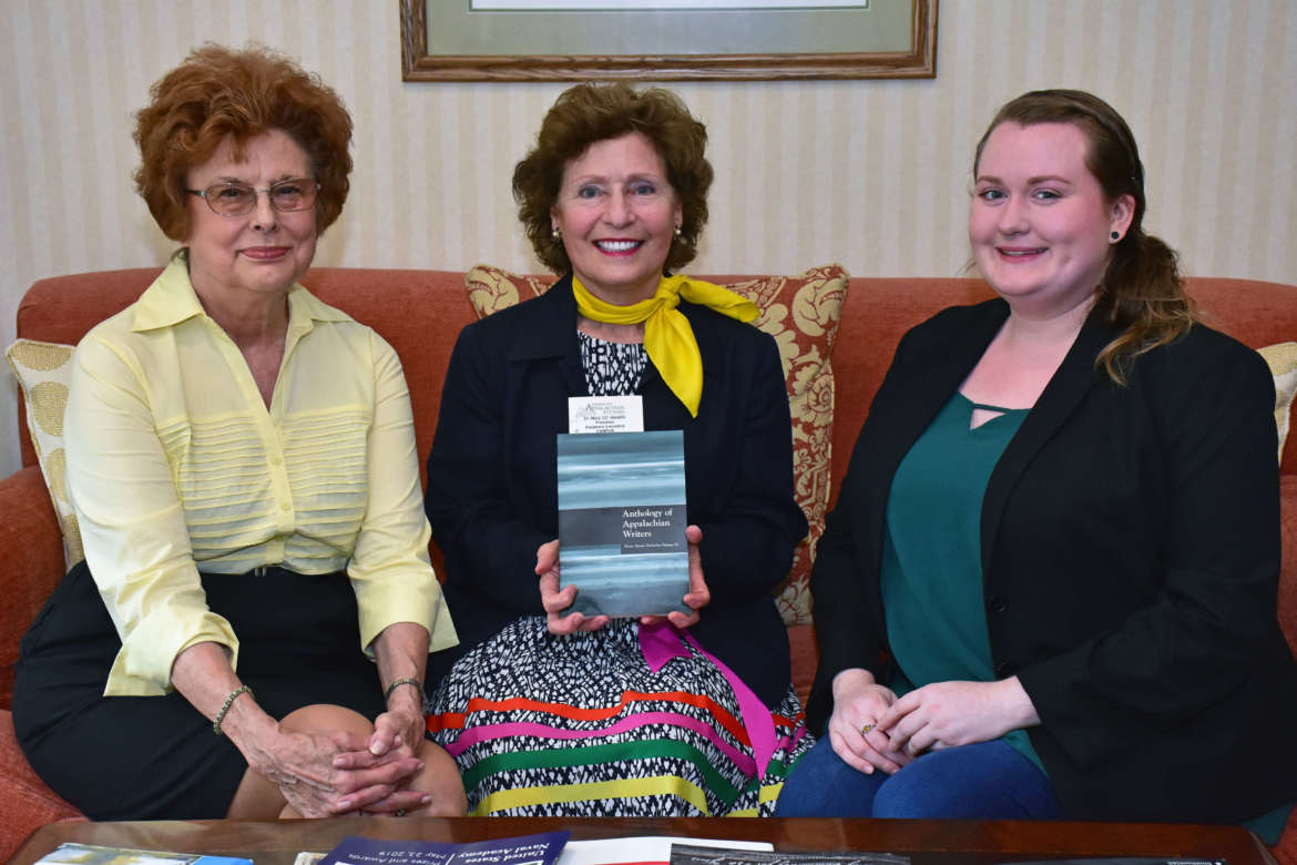 """Pictured (l. to r.) are Dr. Sylvia Bailey Shurbutt, director, Shepherd Center for Appalachian Studies and Communities; Dr. Mary J.C. Hendrix, Shepherd president; and Caitlyn Sheets, student editor, """"Anthology of Appalachian Writers: Karen Spears Zacharias, Volume XI."""""""
