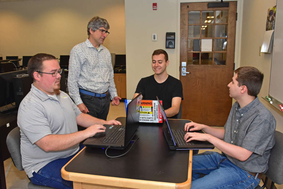 Pictured (l. to r.) are Justin Fisher, a computer and information science major from Martinsburg; Jason Miller, assistant professor in the Department of Computer Science, Mathematics, and Engineering; Nathaniel Pearson, a computer engineering major from Shepherdstown; and Zackery Jaouni, a computer and information science major from Hagerstown, Maryland.