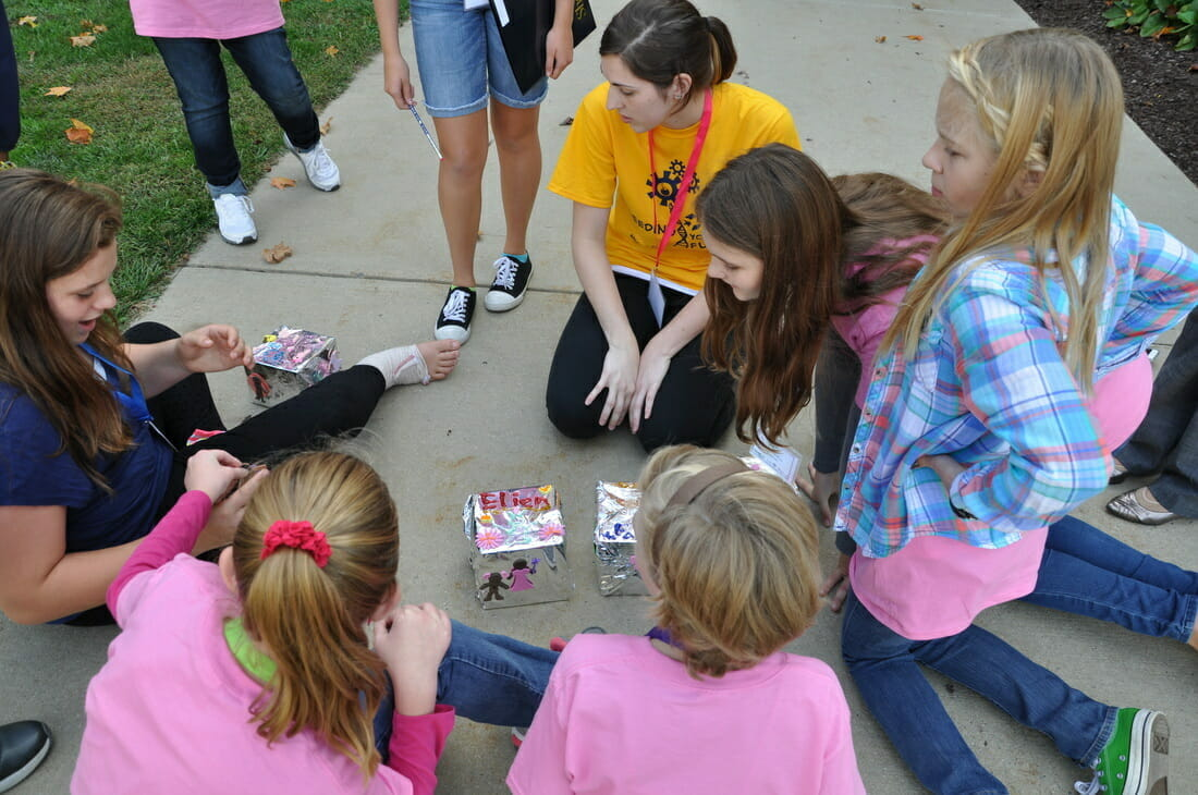 During a previous Seeding Your Future Conference, middle-age school girls work on a science experiment.