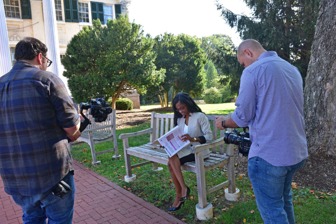 Dr. Arnetta Fletcher reviews some documents while Andrew Gibbs and Saj Adibs of New Slate Films shoot B-roll for a video they are producing about Fletcher.