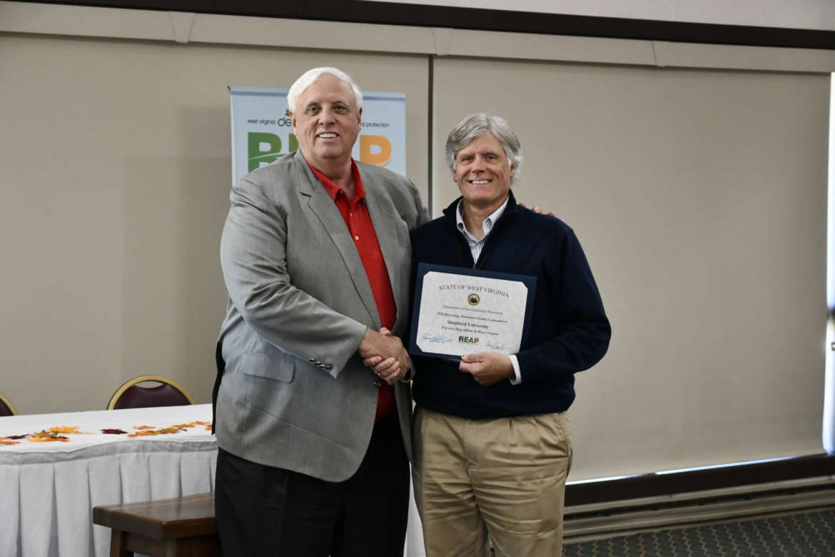 Jim King (r.) accepts a $17,305 Recycling Assistance Grant from Gov. Jim Justice October 21 during the West Virginia Educational Conference on Litter Control and Solid Waste Management at Canaan Valley Resort State Park.