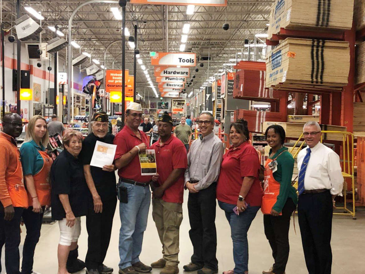 "Pictured (l. to r.) are Joseph Antwi, store manager, Home Depot; Keeley Ciccone, sales associate, Home Depot; Lynne Casto, auxiliary president, VFW; O.W. ""Bud"" Casto, post service officer, VFW; Joe Creager, commander, VFW; Todd Raymond, VFW; Dr. Peter Vila, associate professor, environmental studies, and director, Tabler Farm: Shepherd University Agricultural Innovation Center; Catt Creager, conductress, VFW Auxiliary; Rachel Waters, operations manager, Home Depot; and Jim Staley, Shepherd alumnus and Vietnam veteran."