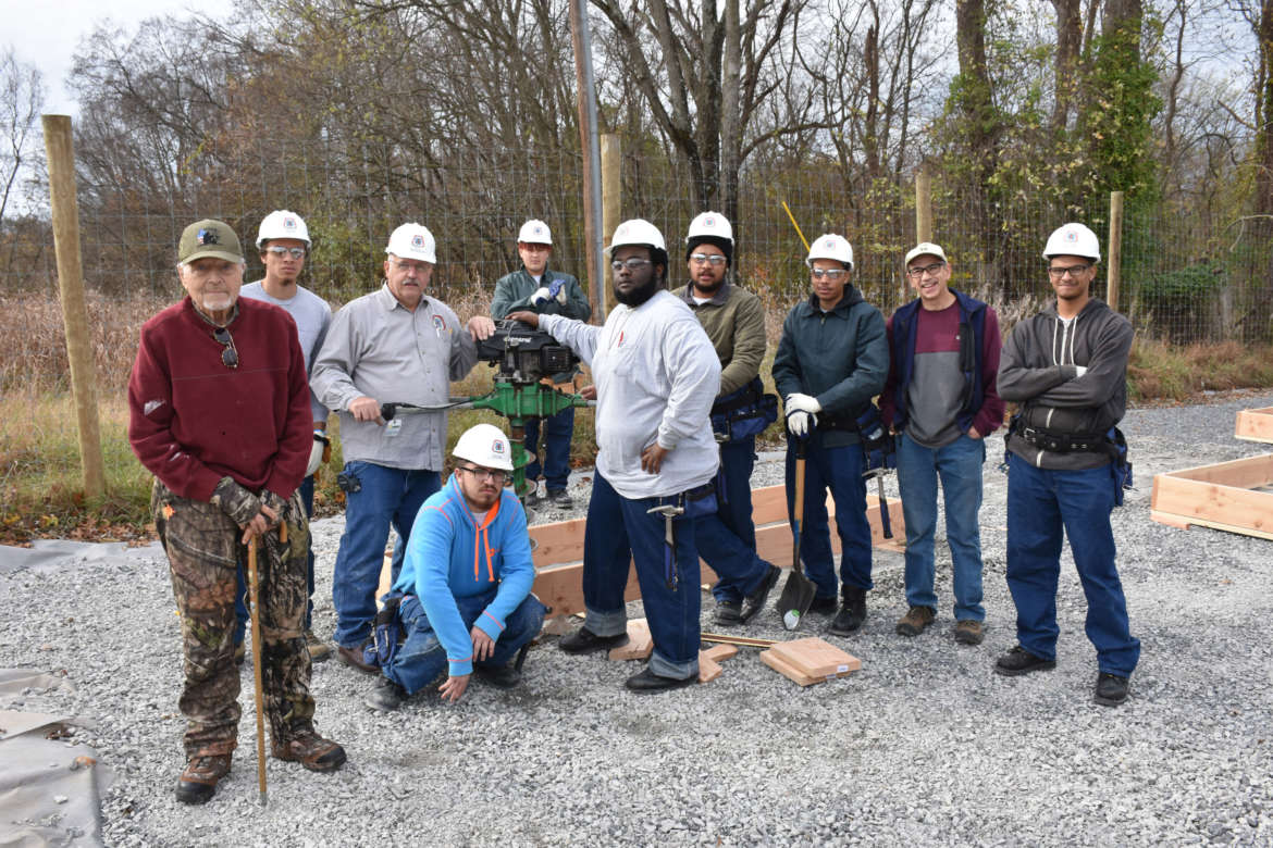 Pictured (from l. to r.) are Bud Casto, U.S. Army veteran and VFW member; Demetrius Smith, Gettysburg, Pennsylvania; Ron Hartle, Harpers Ferry Job Corps carpentry instructor; Kweli Roper, Ranson; Mark Grainger, Beckley; Brandon Hood, Laurel, Maryland; Jaelin Craig, Severn, Maryland; Dr. Peter Vila, associate professor, environmental studies, and director, Tabler Farm: Shepherd University Agricultural Innovation Center; Aaron Taveras, Joppatown, Maryland; and kneeling, Brandon Mullen, Beltsville, Maryland.