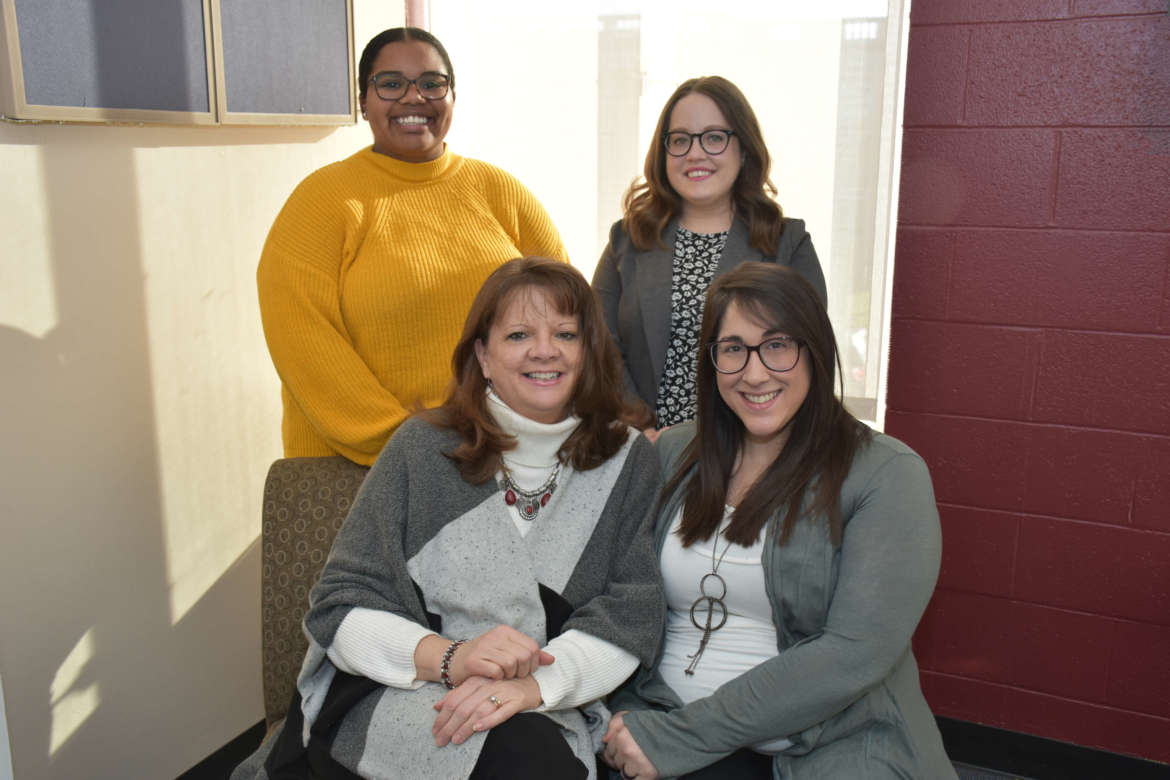 Pictured (seated, l. to r.) are Holly Morgan Frye, interim vice president for student affairs, and Julia Franks, director of student success and orientation programs; standing, Maya Gonzalez, graduate assistant for student success and orientation programs, and Hannah Williams-McNamee, success coach.