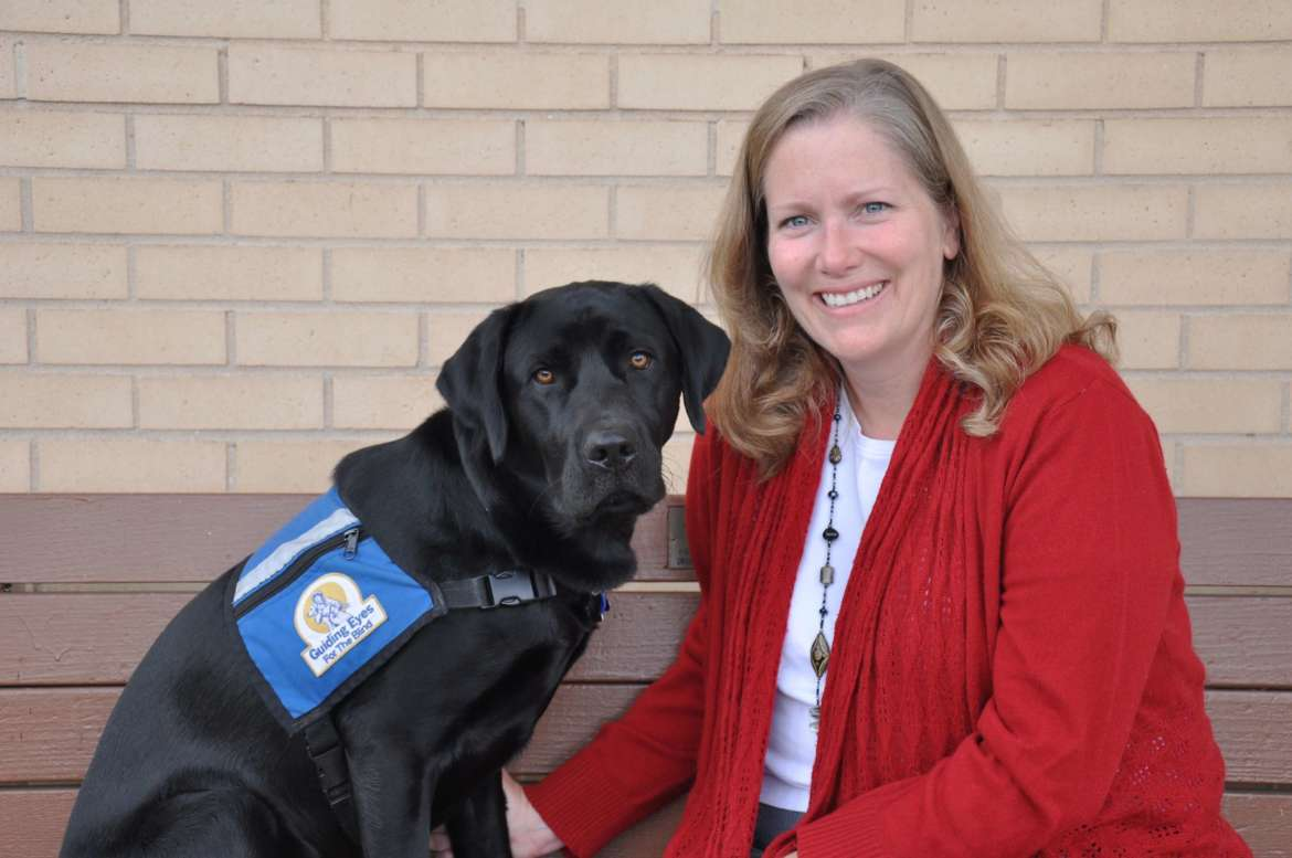 Dr. Amy L. DeWitt poses with Luther, a Guiding Eye for the Blind dog she raised.