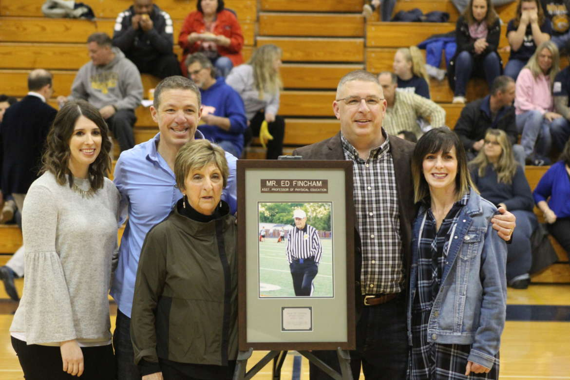 Family members of Ed Fincham were present when he was honored during halftime at the February 8 women's basketball game were (l. to r.)  daughter-in-law Amy Fincham, son Andrew Fincham, wife Sophia Fincham, son Chris Fincham, and daughter-in-law J.J. Fincham.