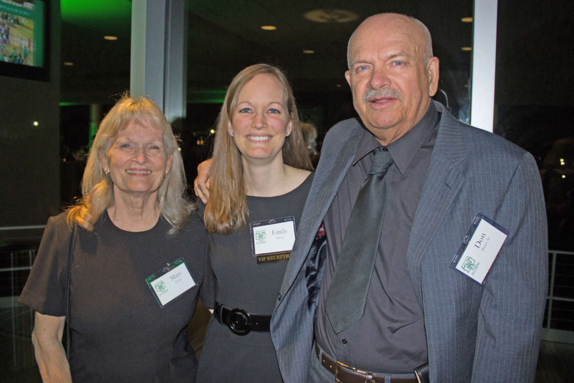 Emily Mauzy (c.) is shown with her parents, Shepherd alumni Mary '73 and Don '73 Mauzy.