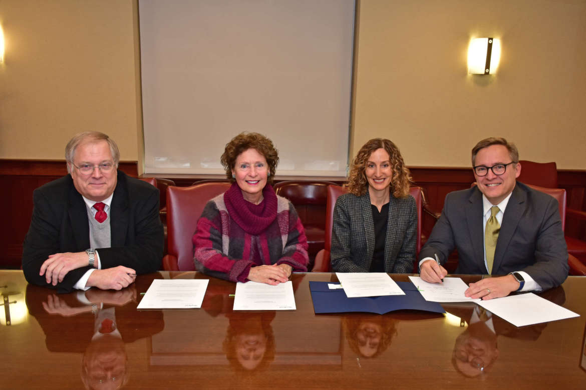 Pictured (l. to r.) are Dr. Ben Martz, dean, College of Business; Dr. Mary J.C. Hendrix, president; Mary Logan Hoxton; and Rob Hoxton.