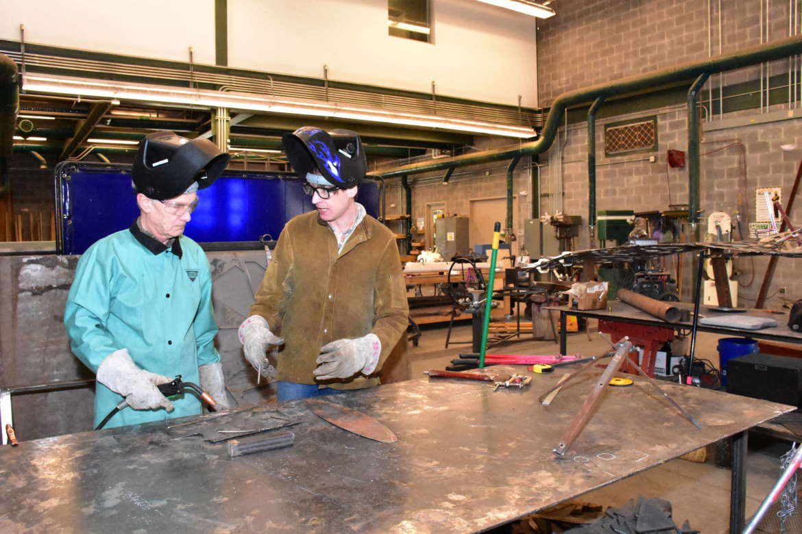 Kay Dartt (r.) discusses welding basics with Lifelong Learning student.