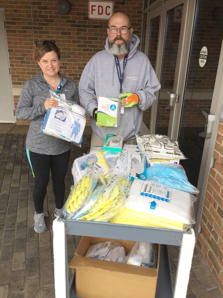 Angela Fetty, Shepherd assistant professor of nursing (l.) and Treavis Twigg, Berkeley Medical Center facilities, bring supplies out of Erma Ora Byrd that were donated to Berkeley Medical Center to help with the COVID-19 pandemic