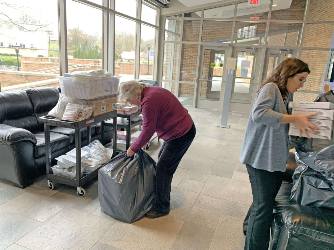Dr. Charlotte Anderson (l.), visiting professor of nursing, and Kayla Landsberger, grant project coordinator, get supplies ready for transport to Berkeley Medical Center.