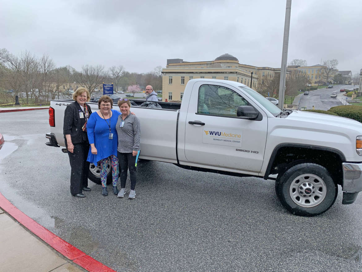 Pictured (l. to r.) are Dr. Sharon Mailey, director, Shepherd School of Nursing; Dr. Doris Burkey, associate professor of nursing; and Angela Fetty, Shepherd assistant professor of nursing. Treavis Twigg, Berkeley Medical Center facilities, is behind the truck.